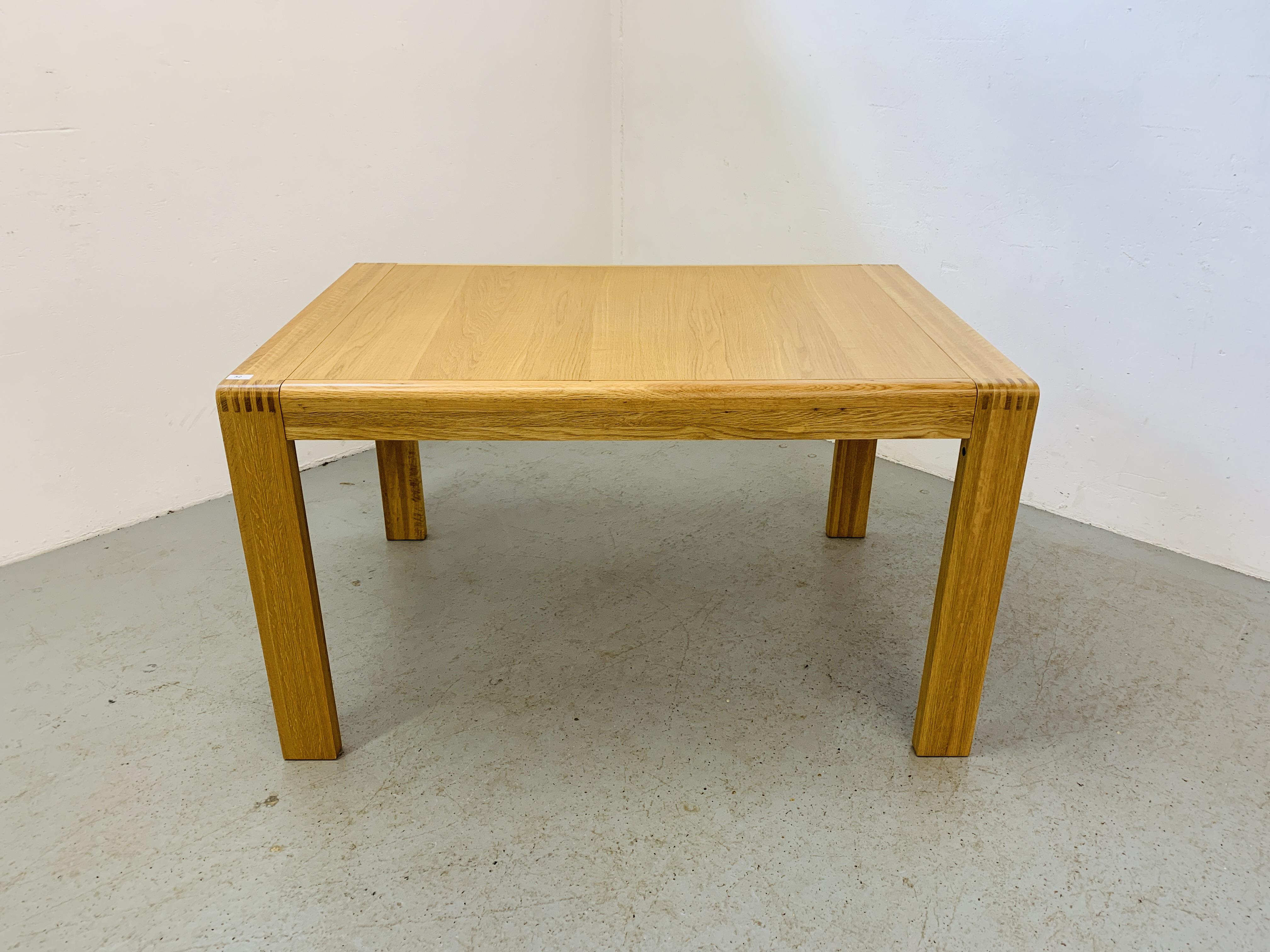 "AN ERCOL ""BOSCO"" OAK DESIGNER DINING TABLE 130CM X 90CM"
