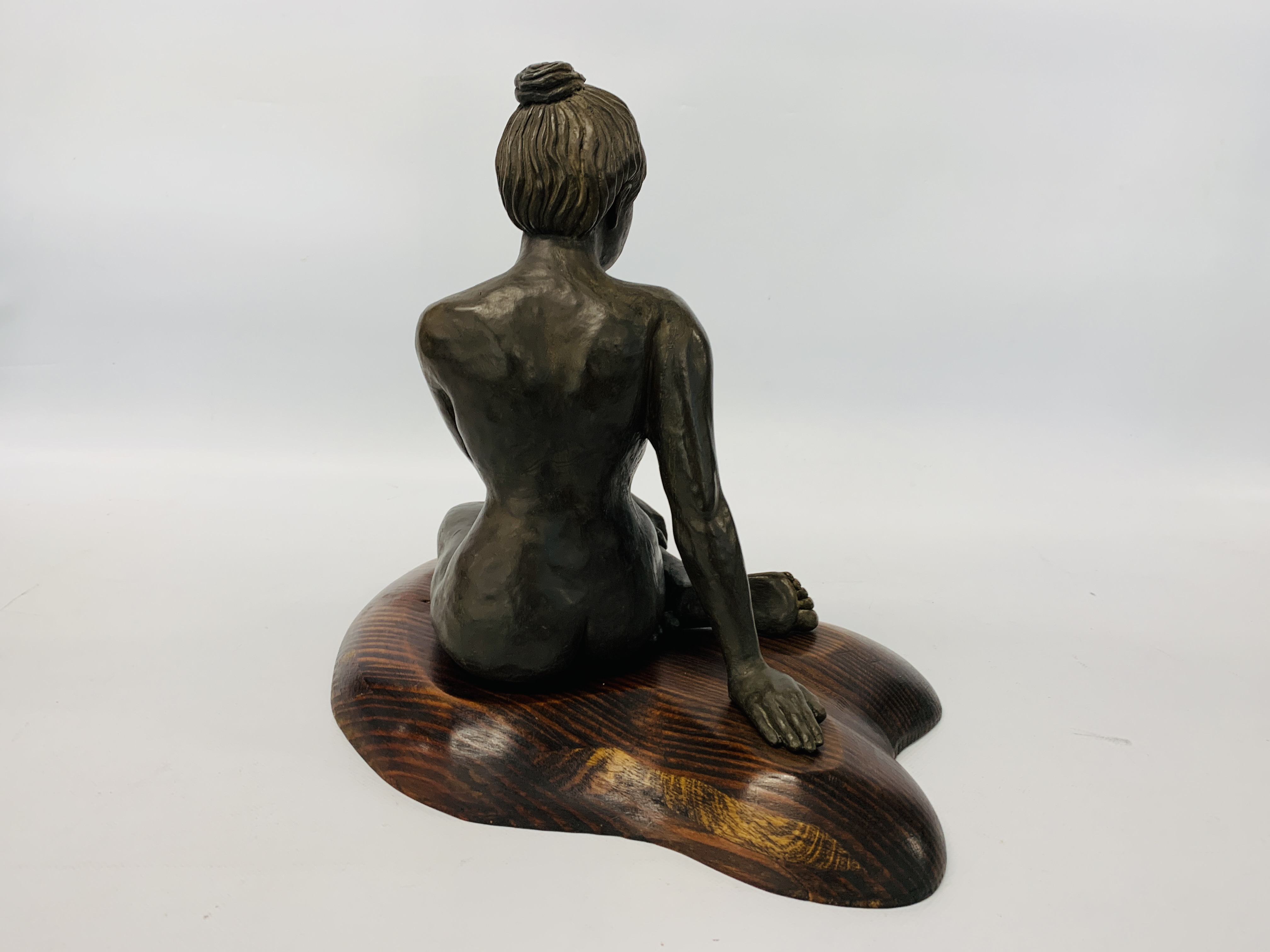 A BRONZED RESIN SCULPTURE OF A SEATED WOMAN BY SONIA DOBBS ON PINE BASE - HEIGHT 33.5 CM. - Image 7 of 8