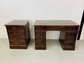 A REPRODUCTION MAHOGANY FINISH NINE DRAWER KNEE HOLE DESK WITH GREEN TOOLED LEATHER INSERT TO TOP