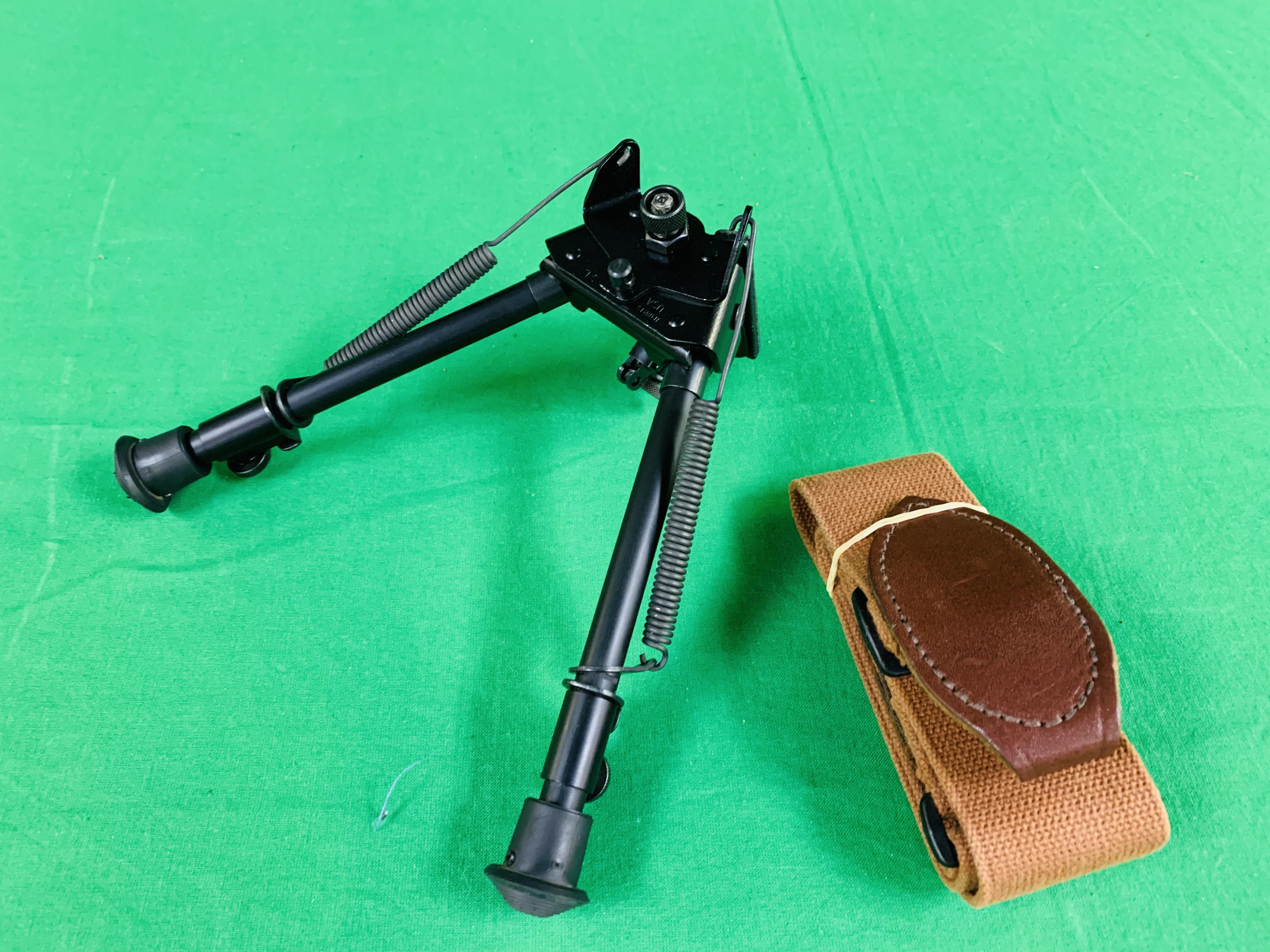 A HARRIS 30CM BIPOD NON STEP LOCKING ALONG WITH A CANVAS RIFLE SLING