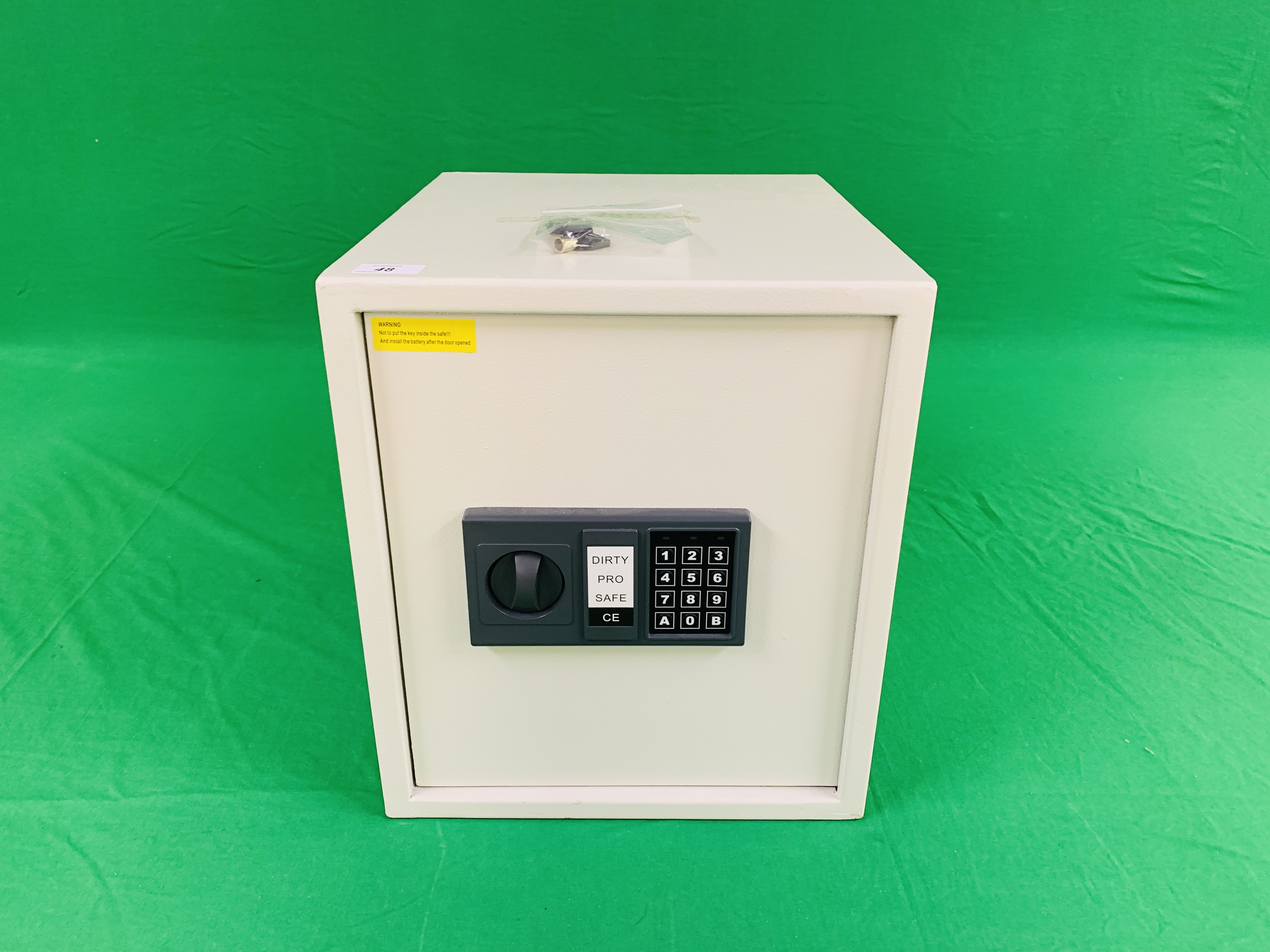 DIRTY PRO SAFE CE ELECTRIC COMBINATION SAFE COMPLETE WITH INSTRUCTIONS ALONG WITH FOUR AS NEW AMTA