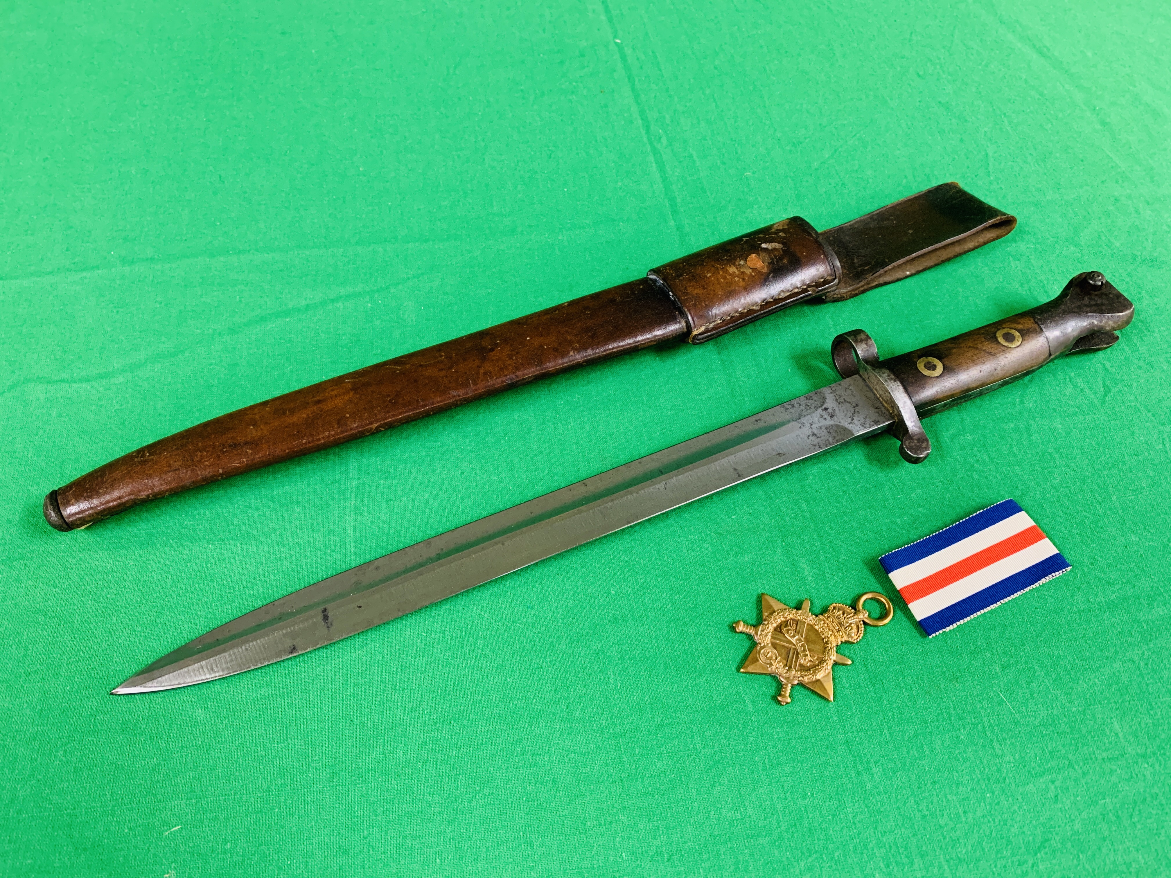 A VICTORIAN BAYONET FOR LEE ENFIELD RIFLE WITH A MK3 NAVAL LEATHER SCABBARD ALONG WITH THE RELATING