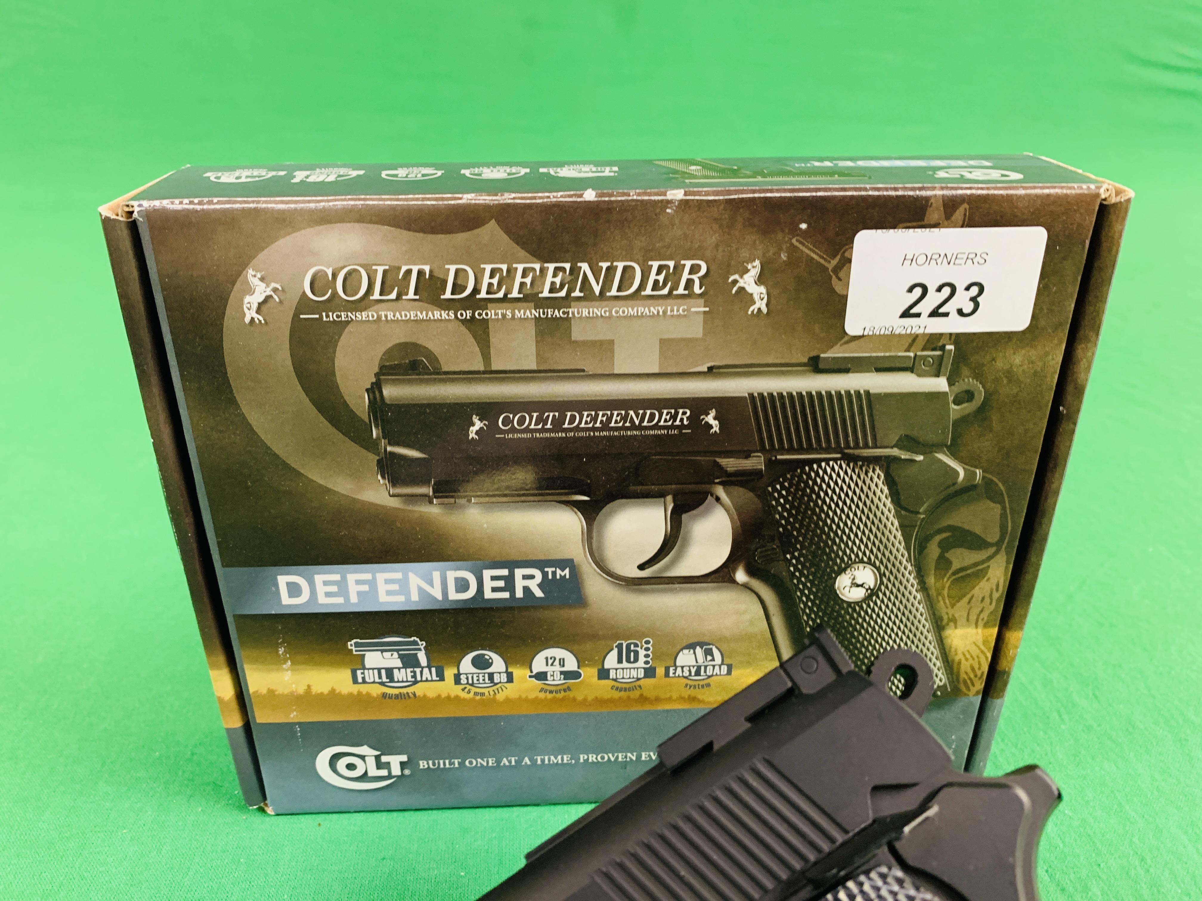 A COLT DEFENDER 16 ROUND . - Image 3 of 10