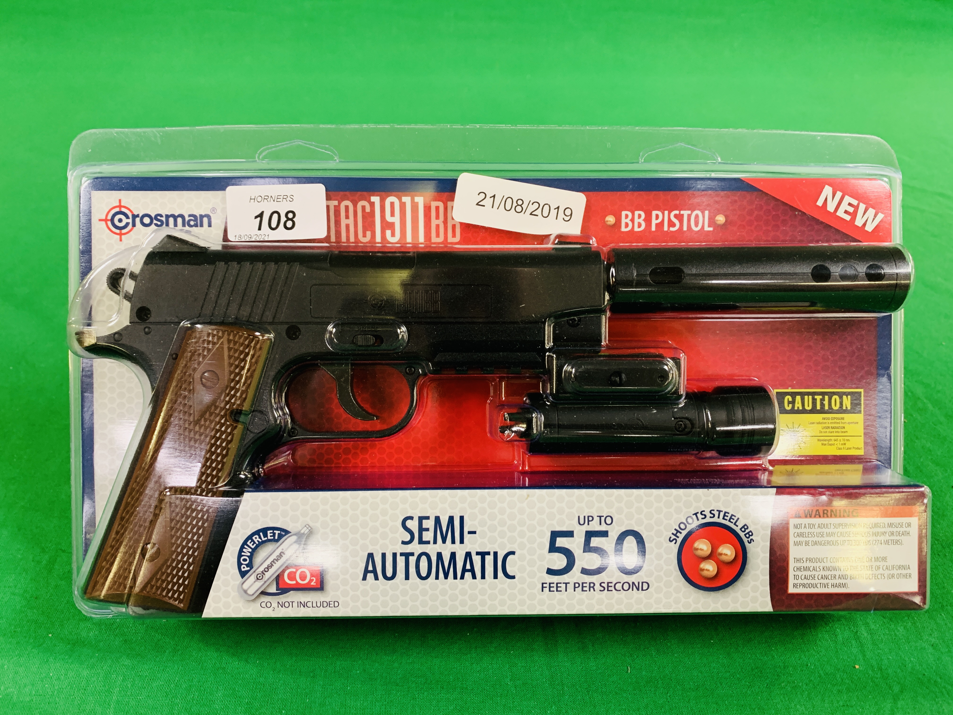 A CROSSMAN TAC SEMI-AUTOMATIC 1911 BB CO² AIR PISTOL WITH LASER BOXED AS NEW - (ALL GUNS TO BE