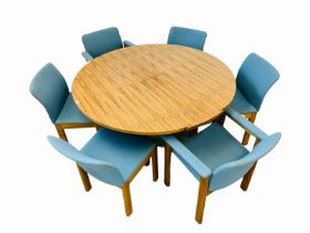 A C20TH BRAZILIAN ROSEWOOD RETRO OVAL TOP DINING TABLE WITH REVOLVING EXTENDING ACTION (TWO LEAF