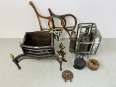 A PAIR OF HEAVY CAST IRON BENCH ENDS (ONE A/F), A HEAVY CAST METAL FIRE BASKET, CAST IRON KETTLE,