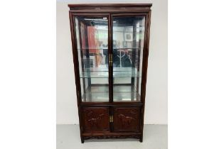 A REPRODUCTION ORIENTAL STYLE HARDWOOD DISPLAY CABINET WITH CABINET BASE,