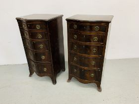 A PAIR OF REPRODUCTION MAHOGANY FINISH SERPENTINE FIVE DRAWER CHESTS