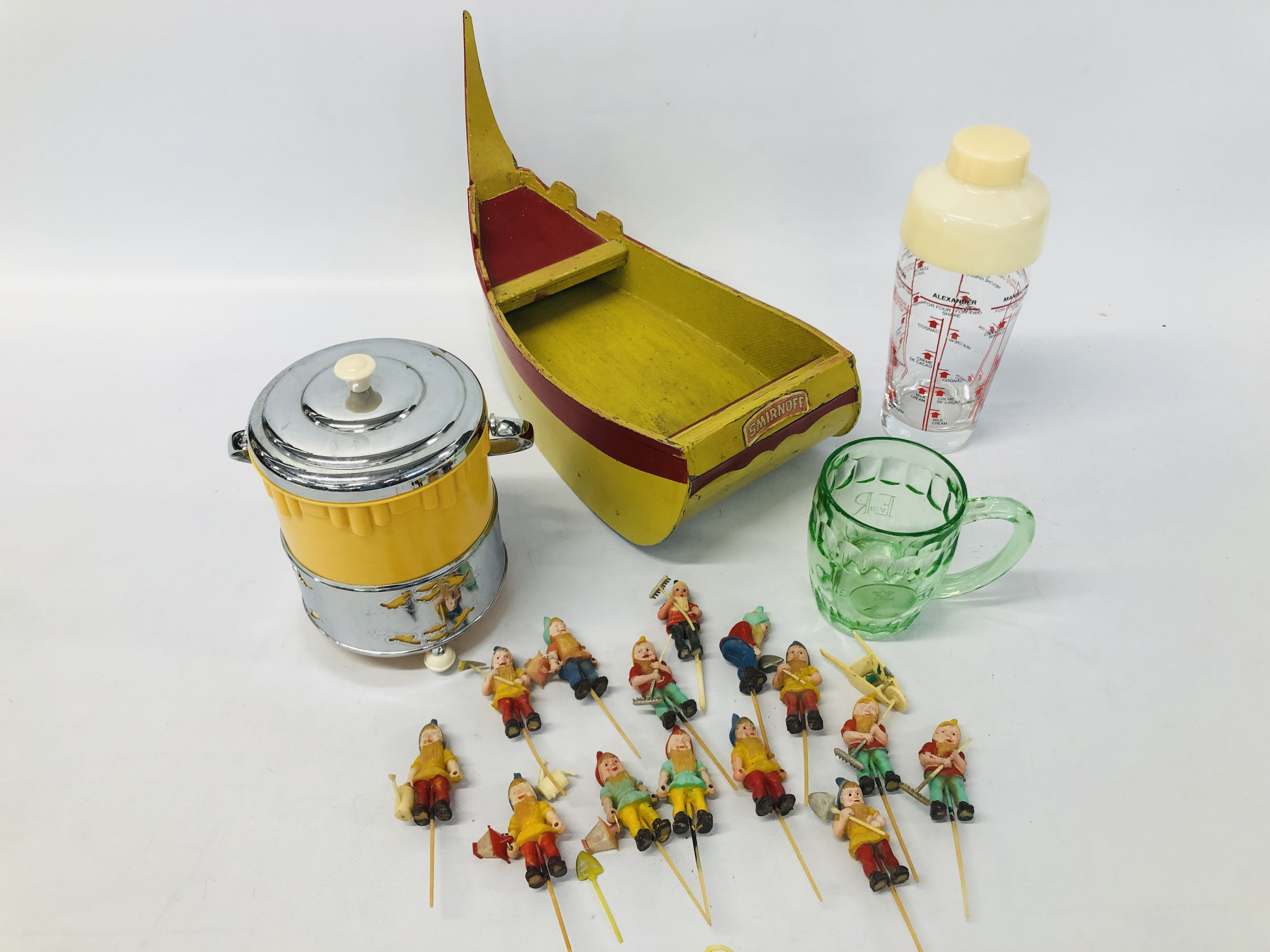 VINTAGE SMIRNOFF DISPLAY IN THE FORM OF A BOAT ALONG WITH A COLLECTION OF GNOME COCKTAIL STICKS,