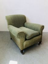 PERIOD GREEN UPHOLSTERED LOW ARM CHAIR