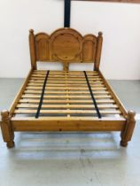 HEAVY SOLID PINE KINGSIZE BEDSTEAD WITH CARVED DETAIL TO HEADBOARD