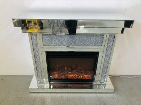 A MODERN DESIGNER MIRRORED GLASS ELECTRIC FIRE SURROUND WITH FLAME EFFECT - SOLD AS SEEN