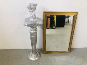 A GILT FRAMED BEVELLED GLASS MIRROR AND A SILVERED FINISH TORCHIERE WITH CHERUB FIGURE - SOLD AS