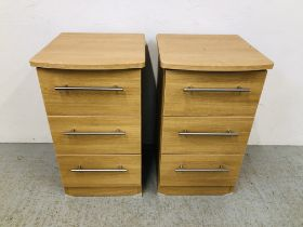 PAIR OF MODERN LIGHT OAK FINISH THREE DRAWER BEDSIDE CHESTS