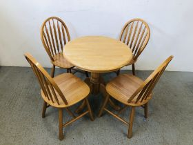 MODERN SINGLE PEDESTAL BREAKFAST TABLE ALONG WITH A SET OF FOUR HOOP BACK DINING CHAIRS