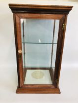 A GLASS DISPLAY CASE IN WOOD FRAME MADE BY FREEMANS NORWICH H 70CM, W 40CM,