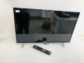 A HITACHI 32 INCH TELEVISION COMPLETE WITH REMOTE - SOLD AS SEEN
