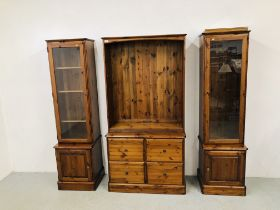 A PAIR OF DUCAL HONEY PINE GLAZED CABINETS WITH CABINET BASES EACH W 51CM. D 44CM. H 89CM.