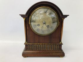 A MAHOGANY CASED MANTEL TIMEPIECE WITH FRENCH STRIKING MOVEMENT - KEY WITH AUCTIONEER