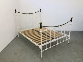 A MODERN VICTORIAN STYLE METAL FRAMED DOUBLE BED FRAME WITH BRASS FINIAL FINISH