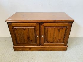 A DUCAL HONEY PINE 2 DOOR CABINET CONCEALING 2 INTERIOR LINED DRAWERS - W 97CM. D 44CM. H 61CM.