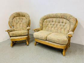 AN ERCOL STYLE COTTAGE SUITE WITH BEECH WOOD FRAME COMPRISING OF 2 SEATER SOFA AND ROCKING CHAIR