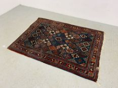 AN EASTERN BLUE / RED PATTERNED RUG 150CM X 110CM.