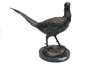 A BRONZE COCK PHEASANT, mounted on a round marble plinth.