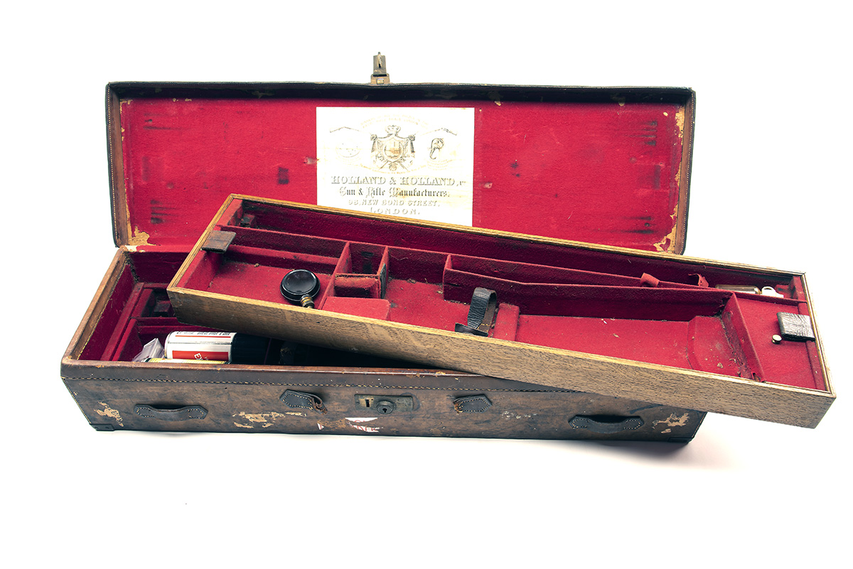 A BRASS-CORNERED LEATHER TWO TIER DOUBLE HAMMERGUN CASE, fitted for 30in. barrels, the interior
