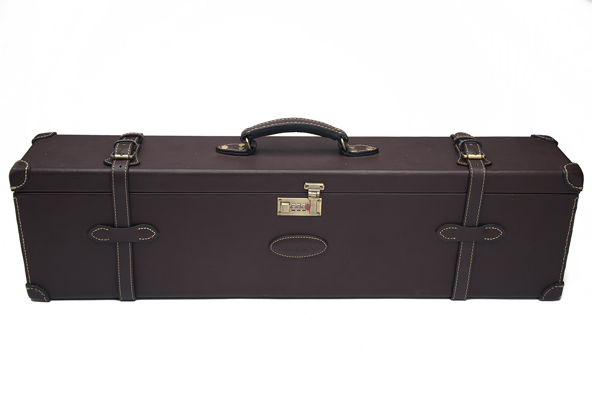 AN UNUSED LEATHER DOUBLE UNIVERSAL GUNCASE, fitted for 31in. barrels, the interior lined with maroon - Image 2 of 2