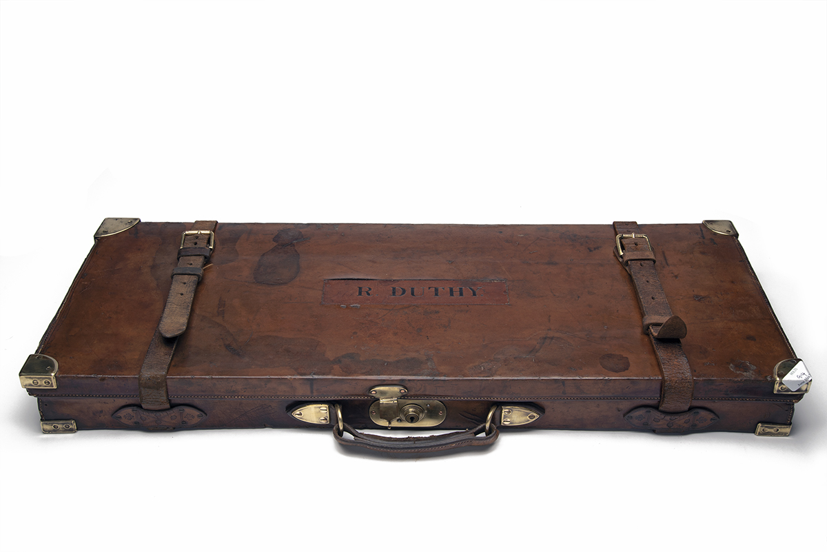 A BRASS-CORNERED OAK AND LEATHER DOUBLE GUNCASE, fitted for 30in. barrels, the interior lined with - Image 2 of 2