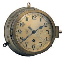 AN EIGHT-DAY BRASS GERMAN WORLD WAR TWO KRIEGSMARINE BULKHEAD CLOCK, serial no. 9937N (6476), of the