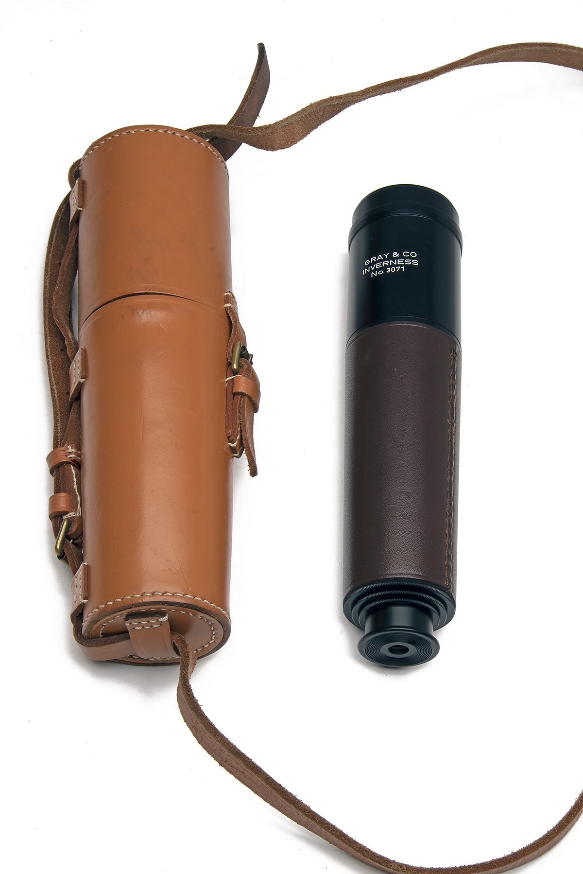 GRAY & CO. (INVERNESS) A LEATHER-BOUND THREE-DRAW STALKING TELESCOPE, no. 3071, with anodised tubes,