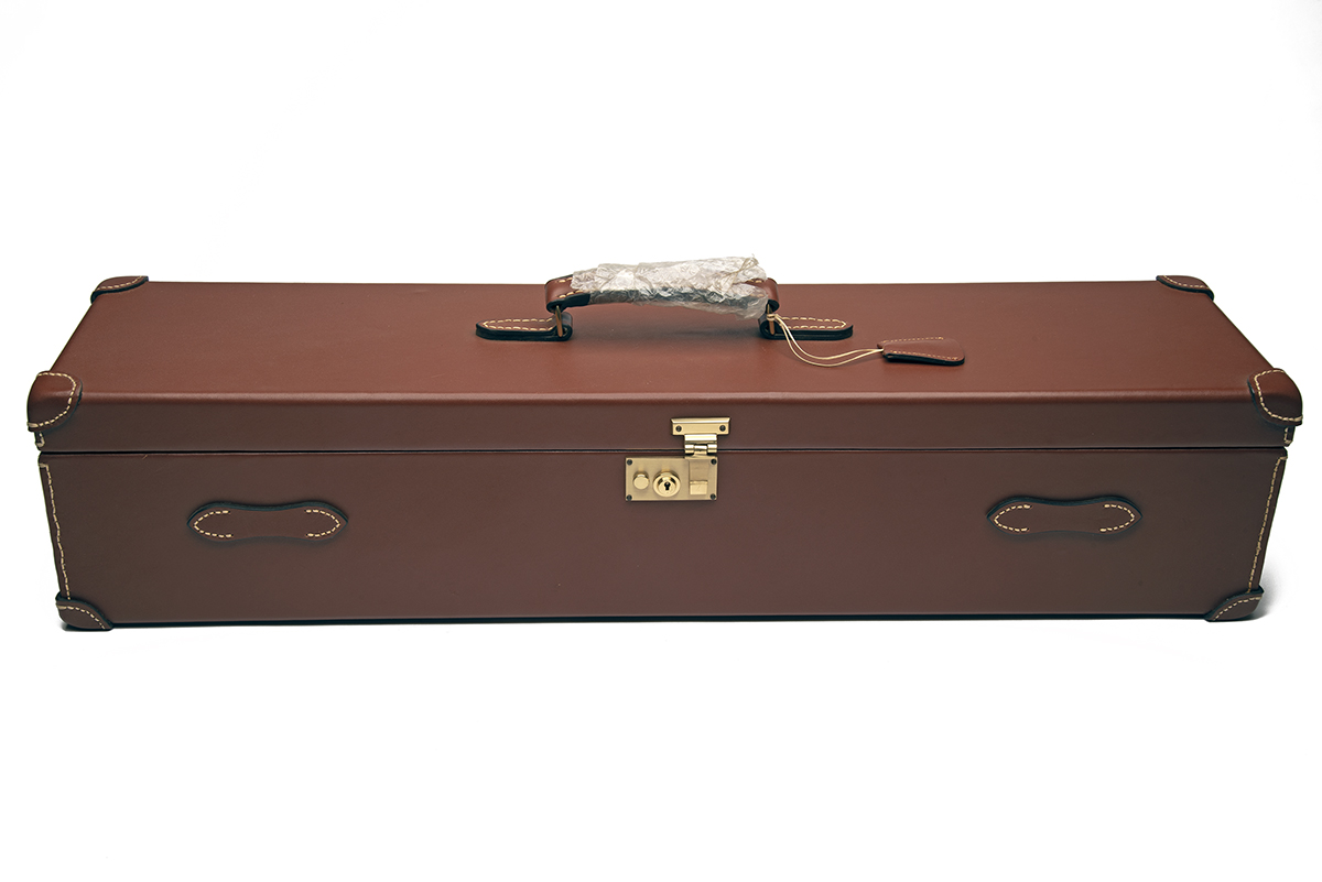 AN UNUSED TAN LEATHER DOUBLE UNIVERSAL GUNCASE, fitted for 31in. barrels, the interior lined with