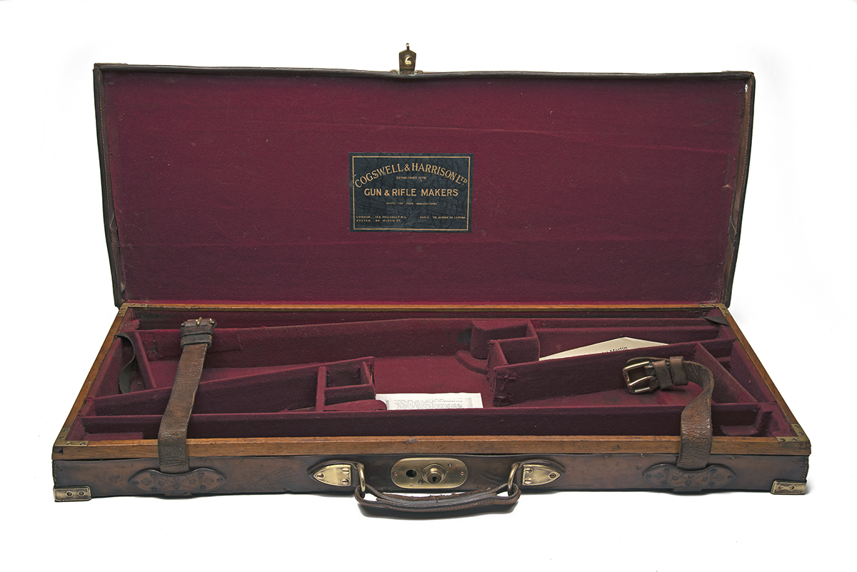 A BRASS-CORNERED OAK AND LEATHER DOUBLE GUNCASE, fitted for 30in. barrels, the interior lined with