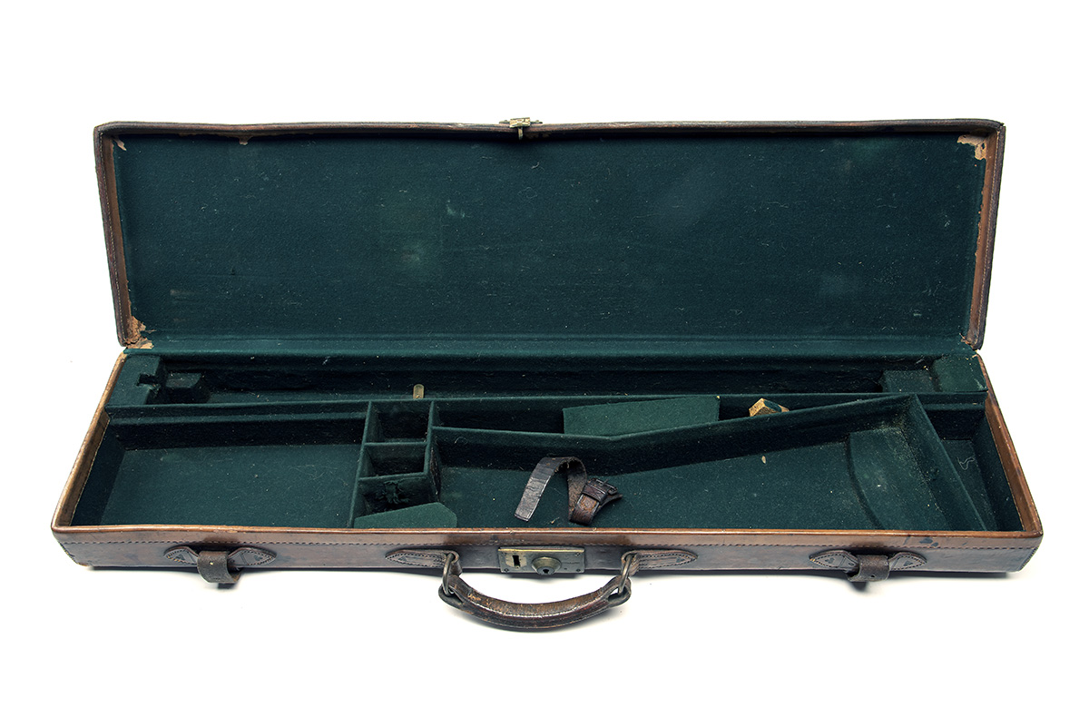 A LEATHER SINGLE GUNCASE, fitted for 30in. barrels (could adapt to 32in.), the interior lined with