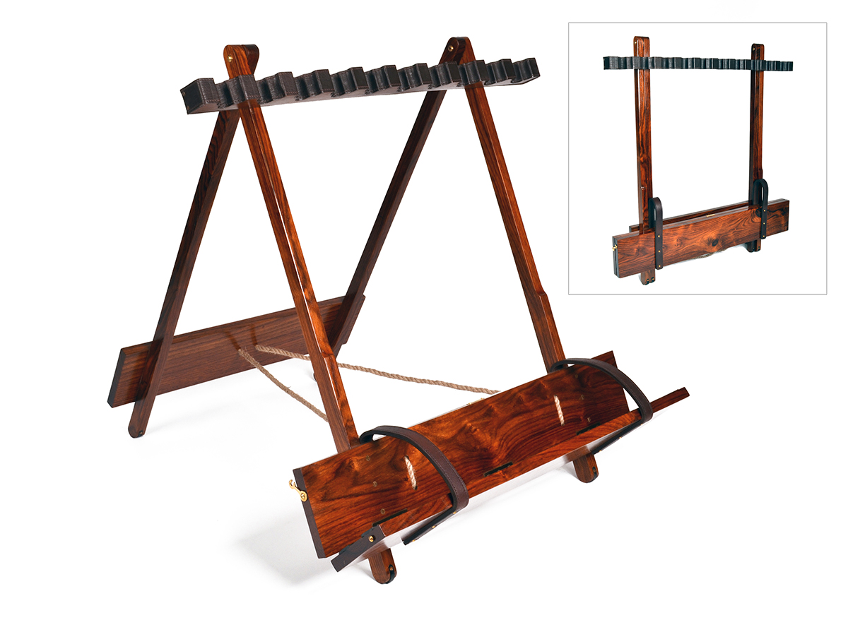A TEAK PORTABLE FOLDING GUN RACK WITH LEATHER LINING AND BRASS MOUNTS, suitable for ten guns.