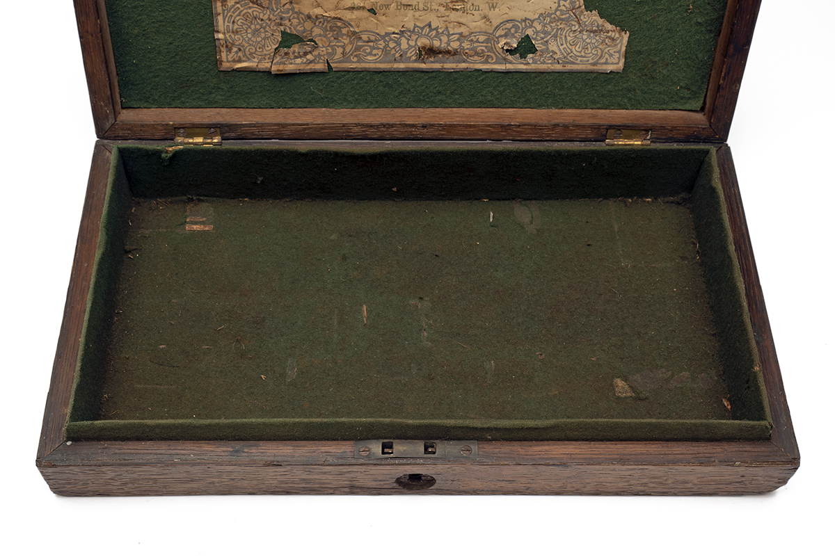 H. HOLLAND, LONDON AN OAK PISTOL or REVOLVER CASE-CARCASS WITH TRADE-LABEL, circa 1850 and almost - Image 2 of 3
