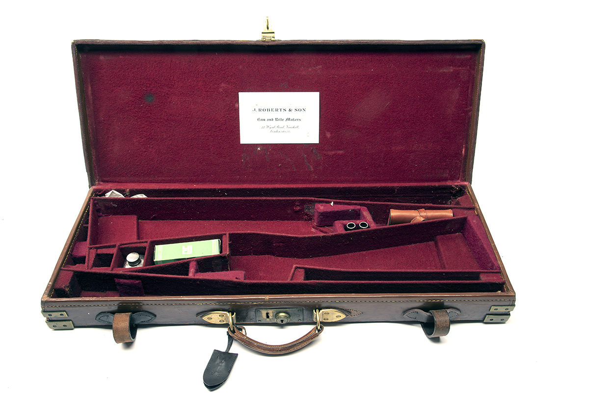 A BRASS-CORNERED LEATHER DOUBLE GUNCASE, fitted for 28in. barrels, the interior lined with maroon