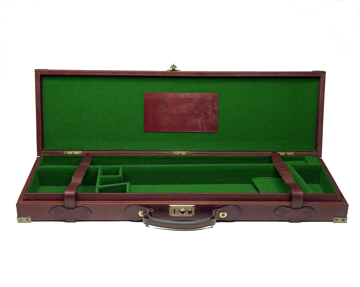 SWAIN ADENEY BRIGG & SONS LTD. A BRASS-CORNERED LEATHER SINGLE GUNCASE, fitted for 29in. barrels (