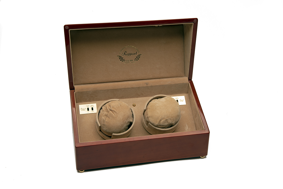 RAPPORT, LONDON A WOOD CASED DUAL AUTOMATIC WATCH-WINDER, mains (UK 240 Volt) or battery operated,