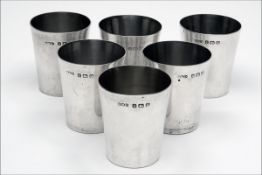 WILMOT MANUFACTURING CO. 1912-1928 A SET OF SIX STERLING SILVER SHOT CUPS, with 'W.M.Co.' silver