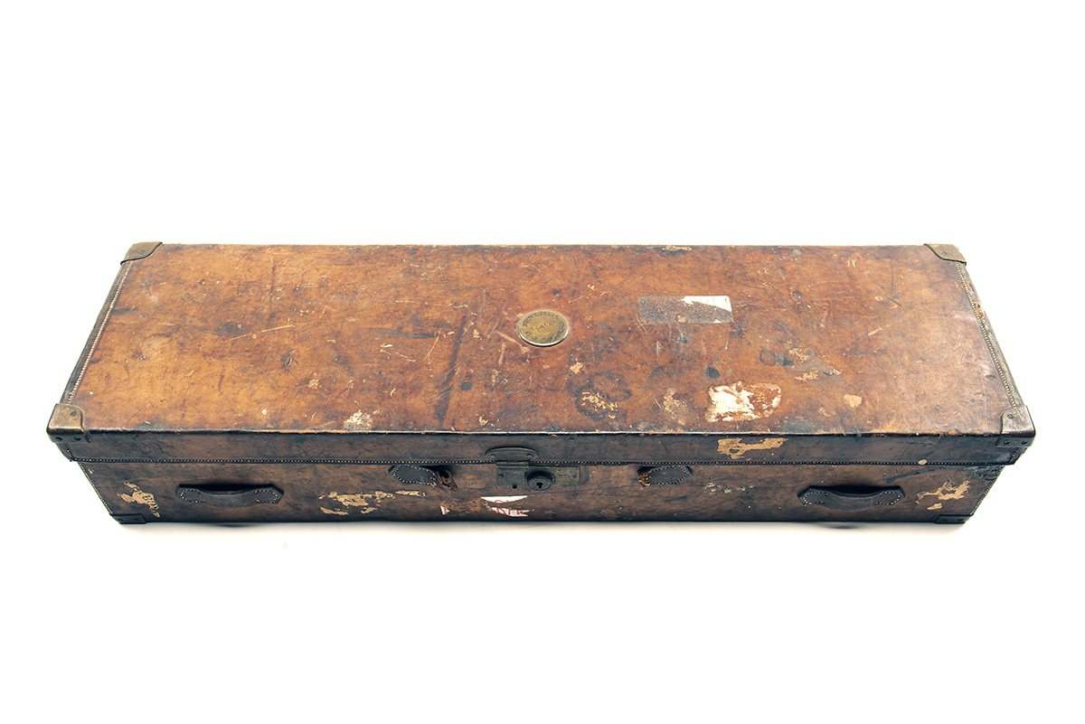 A BRASS-CORNERED LEATHER TWO TIER DOUBLE HAMMERGUN CASE, fitted for 30in. barrels, the interior - Image 2 of 2