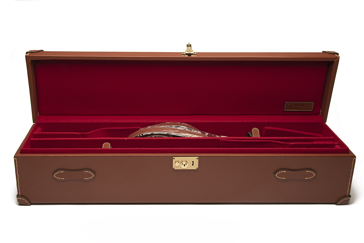 AN UNUSED TAN LEATHER DOUBLE UNIVERSAL GUNCASE, fitted for 31in. barrels, the interior lined with - Image 2 of 2
