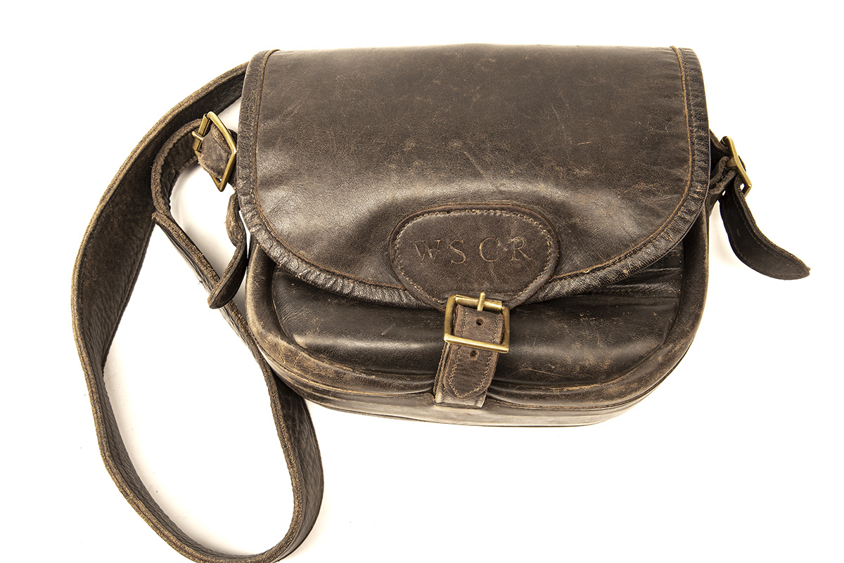 A LEATHER CARTRIDGE BAG WITH FAST-LOADING POCKETS, with canvas and leather shoulder strap and