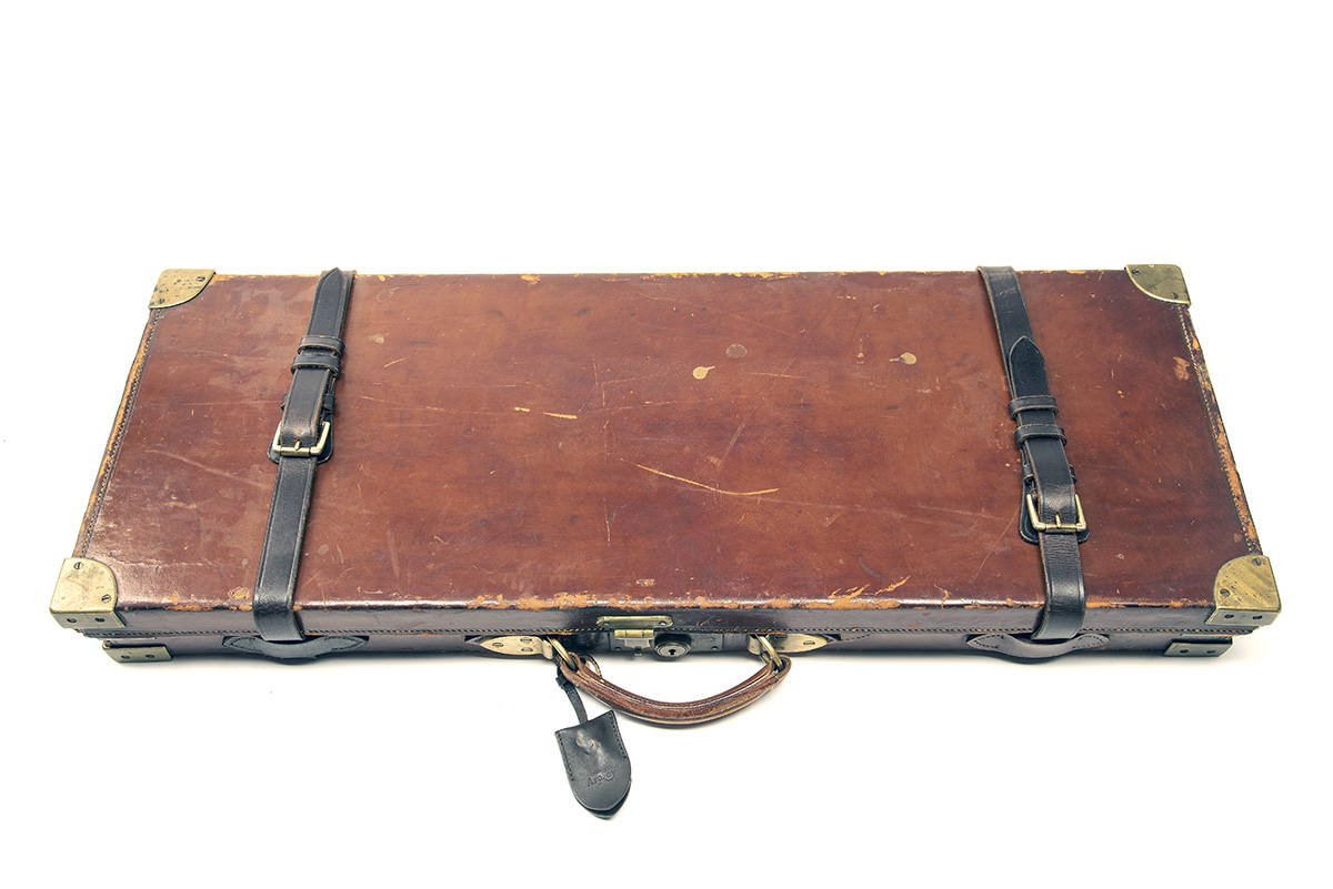 A BRASS-CORNERED LEATHER DOUBLE GUNCASE, fitted for 28in. barrels, the interior lined with maroon - Image 2 of 2