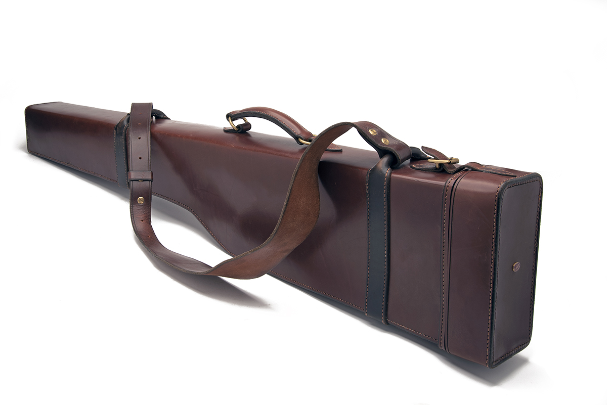 A LEATHER 4-BORE TAKE-DOWN GUNCASE, fitted for 44in. barrels, leather shoulder strap and brass