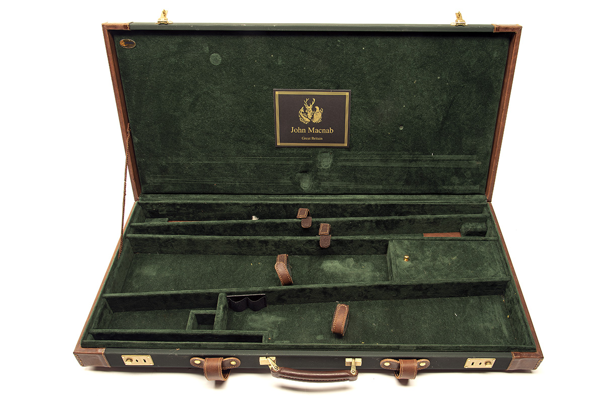 JOHN MACNAB A CANVAS AND LEATHER DOUBLE GUNCASE, fitted for 30in. barrels, the interior lined with