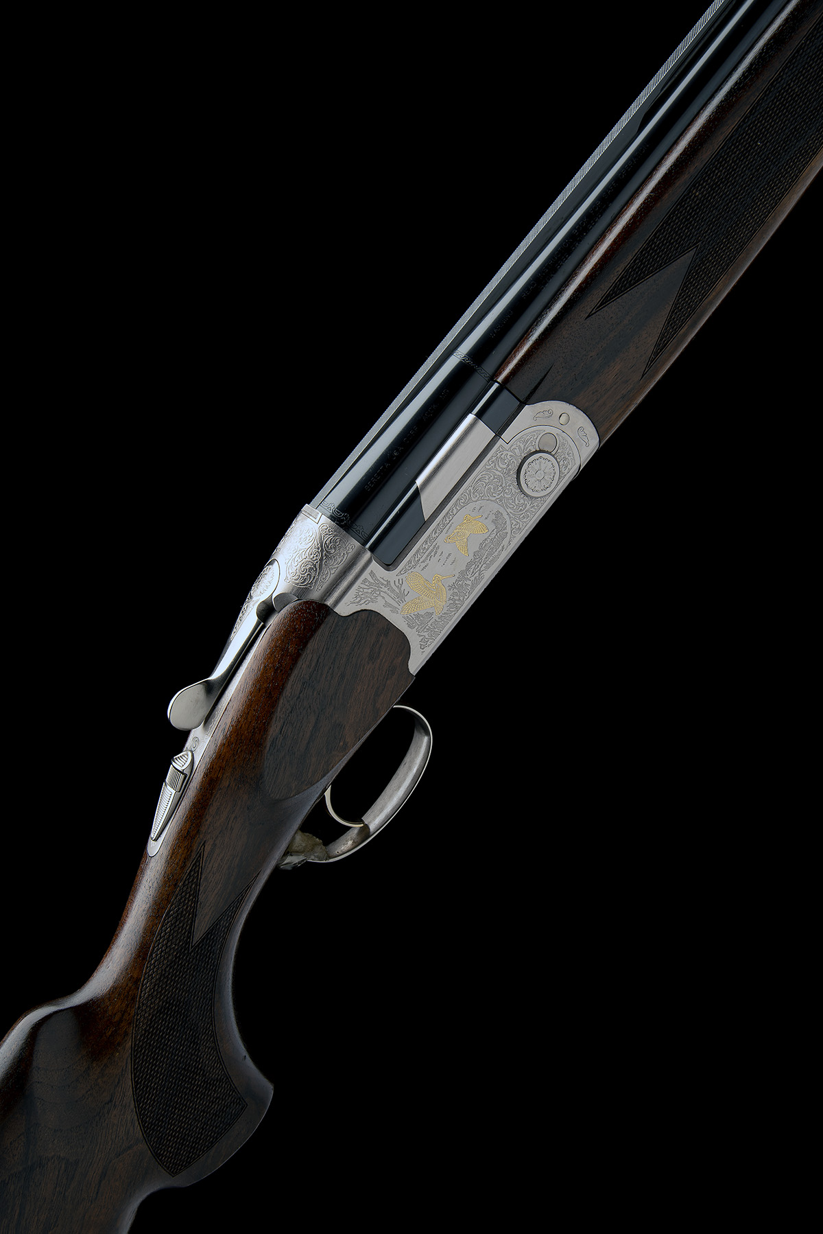 P. BERETTA A 12-BORE 'ULTRA LIGHT DELUXE' SINGLE-TRIGGER OVER AND UNDER EJECTOR, serial no. R00281S,