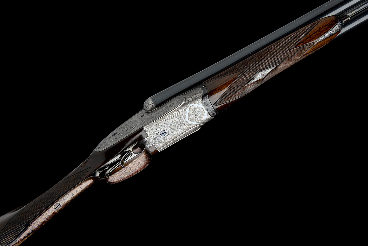T. WILD A 12-BORE SIDELOCK EJECTOR, serial no. 21717, circa 1946, 28in. nitro reproved barrels (in - Image 3 of 8